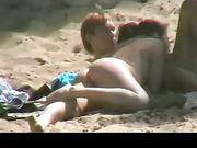 Caught voyeur blowjob at the beach