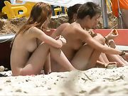 Topless girls filmed voyeur at the beach