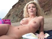 Superb nudist blonde filmed at the beach