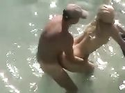Caught voyeur couple doing sex in the water